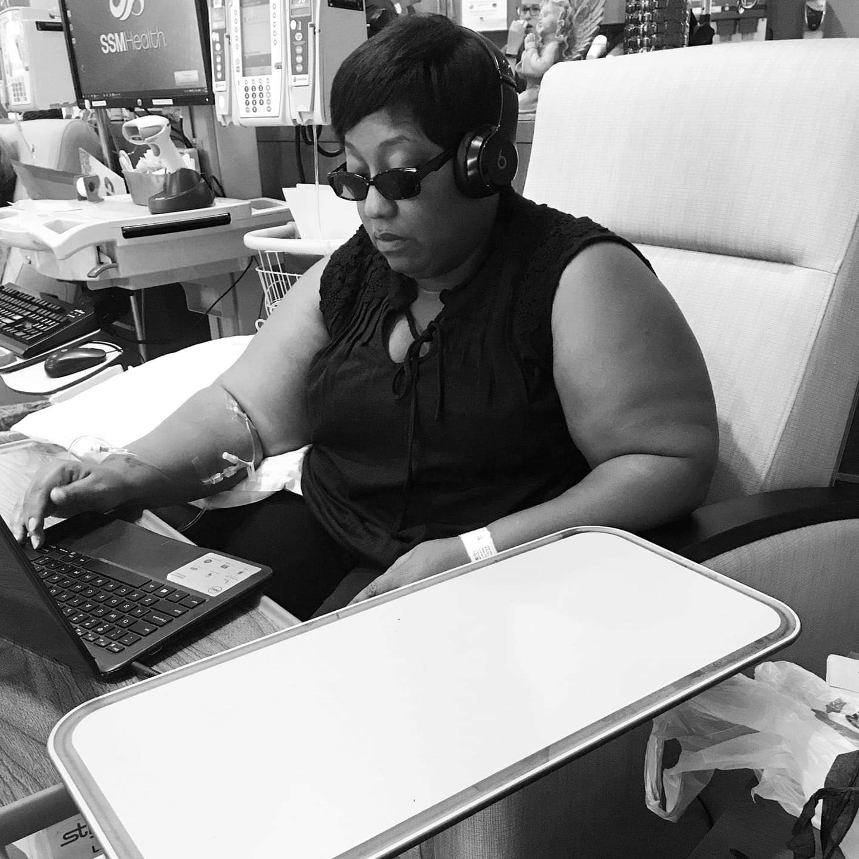 Tasha working and receiving treatment