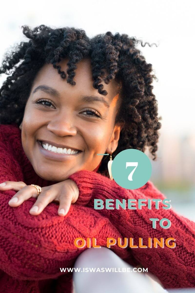 black irl with natural hair smiling with head rested on arms with text 7 benefits to oil pulling